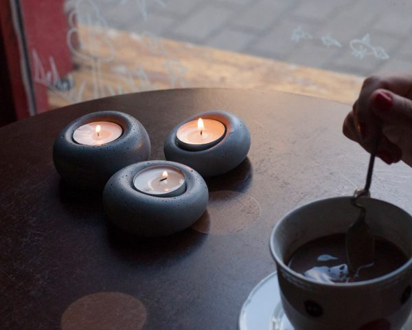 Designer concrete tealight holders at coffee shop