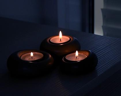 Designer candle holder set lit at night