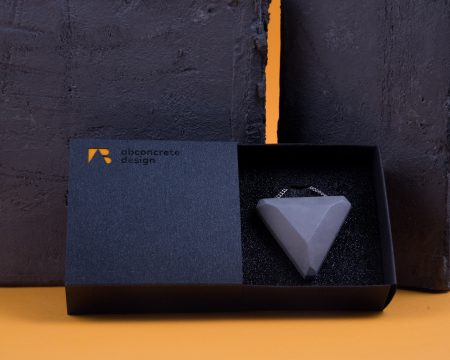Triangle shaped designer pendant made of concrete with giftbox