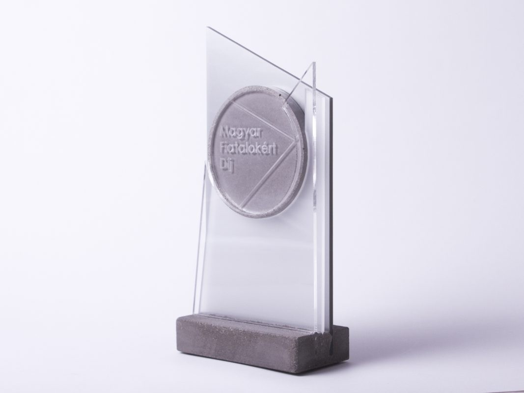 Unique custom made trophy design made of concrete and acrylic glass