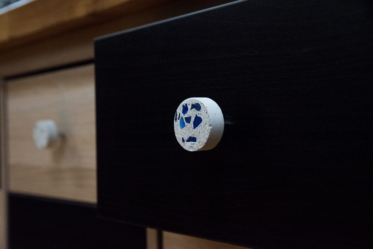 White terrazzo cabinet knobs with blue glass