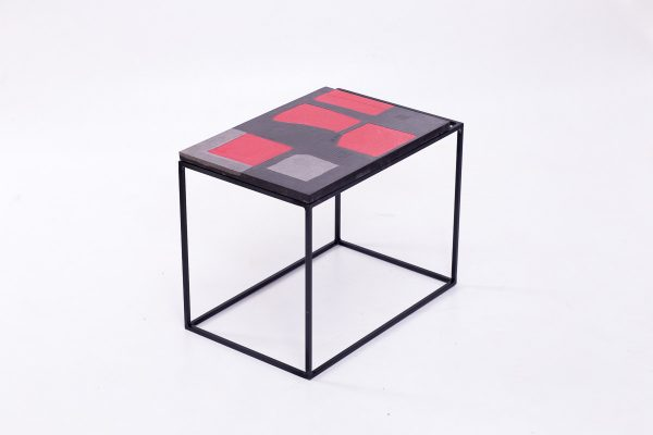 Unique and innovative colored red concrete artwork table for a charity auction