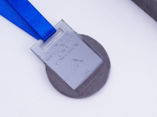 Silver medal for concrete canoe competition made of concrete and acryl