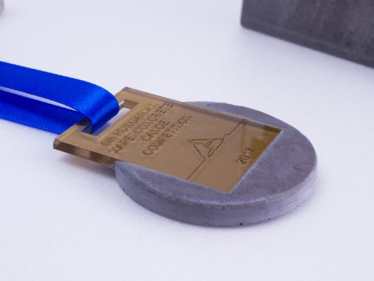 Golden medal made of concrete and plexiglass