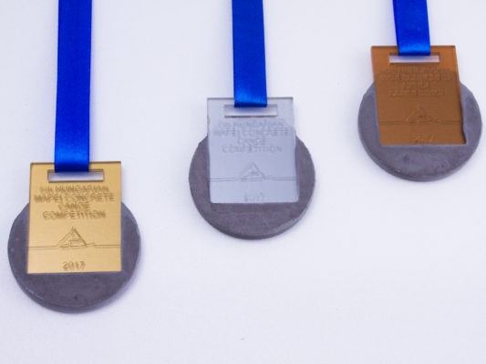 Concrete and acrylic- golden, silver and bronze medals for concrete canoe championship