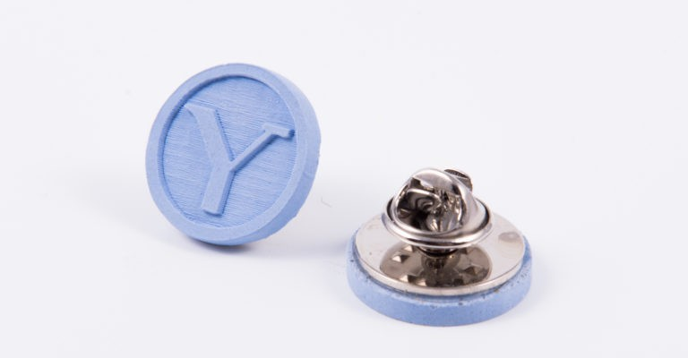 Blue concrete pins with university logo for architecture students
