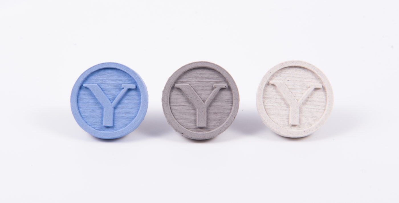 Custom made concrete pins for architecture students with the university's logo