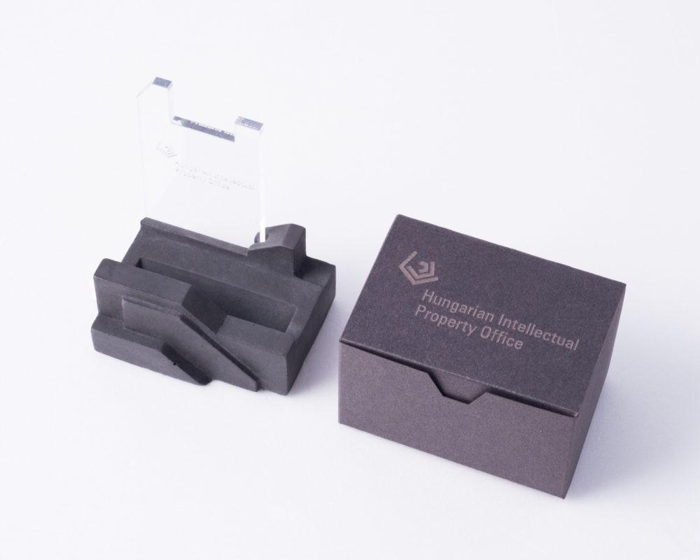Futuristic design office desk pen holder with branded box by concrete designer