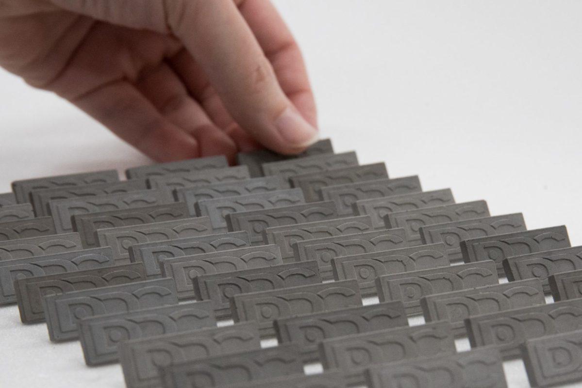 Concrete design badges for institutions