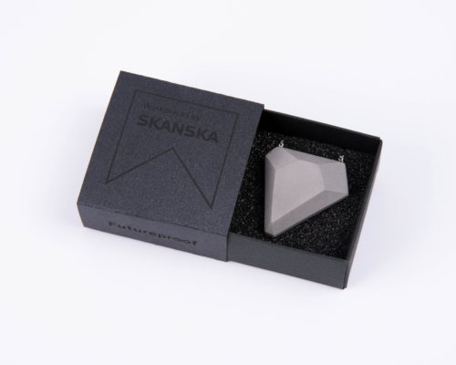 Designer concrete jewel as a business gift with branded giftbox for Skanska