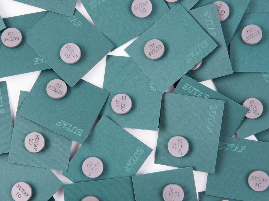 brand identity concrete pins for employee's uniform
